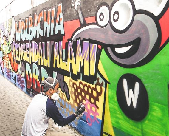 Andri painting the WMP mural